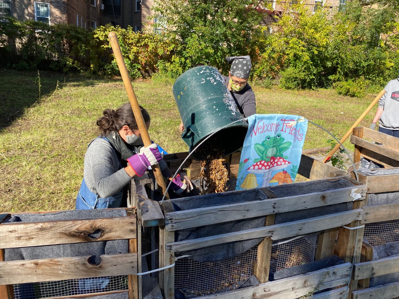 Photo of local residents composting at the Sunnyside lot.