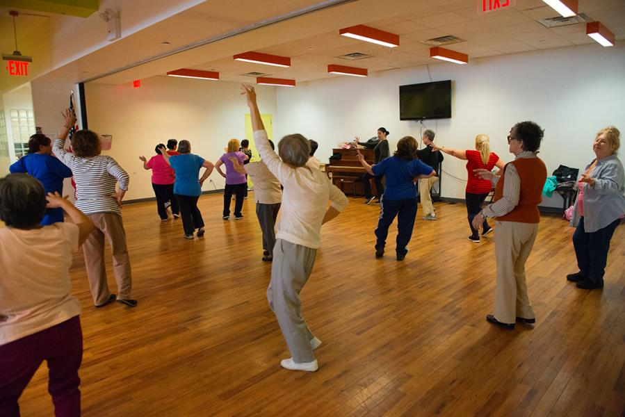 Older adults participate in a group exercise