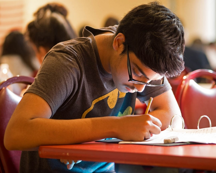 High school student works on an exam