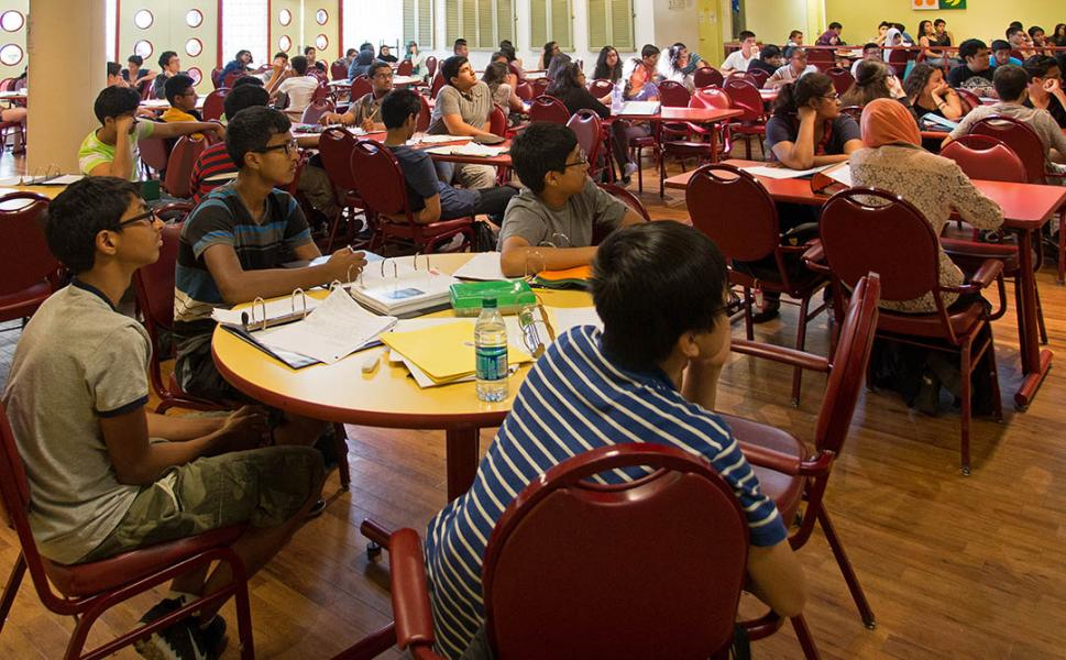 A large gathering of young adults attend a College Readiness session