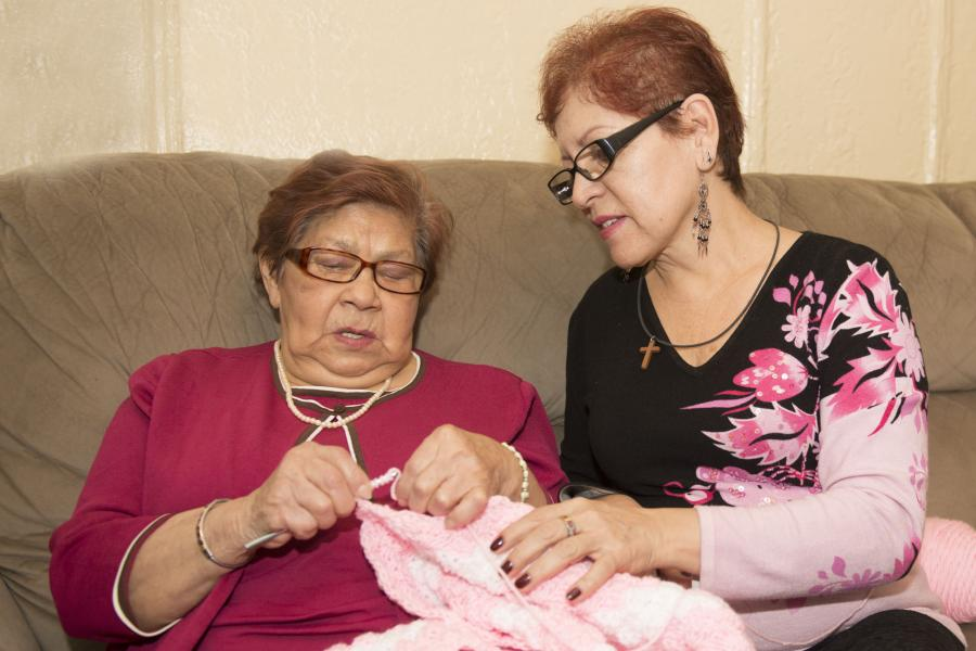 Caregiver and loved one enjoy a quiet moment crocheting together