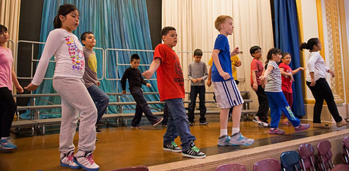 After-school students dance on stage