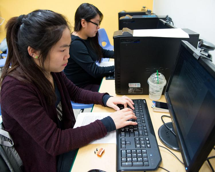 Teens work on computers at the Time Warner Computer Lab at SCS