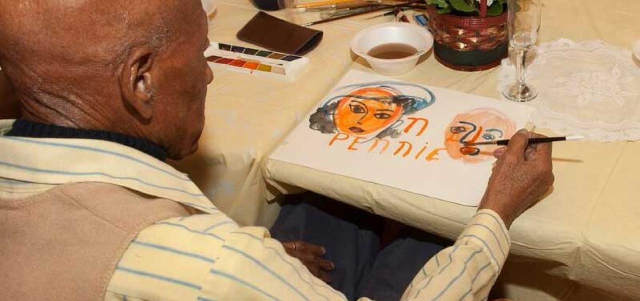 Program participants enjoy creative activities such as painting, shown here.