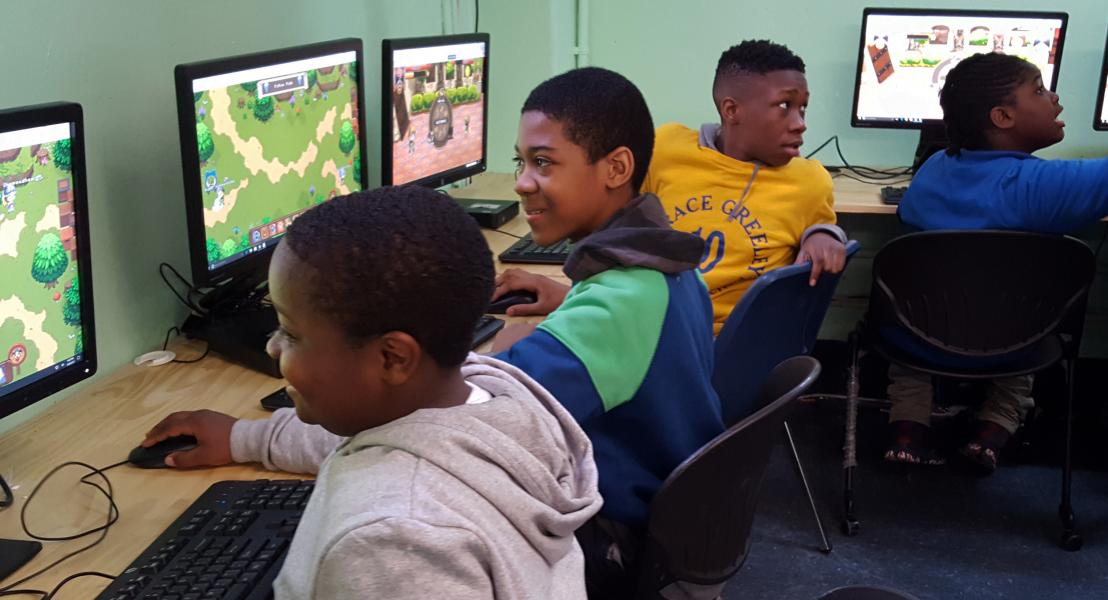 Students enjoying the Computer Lab at the SCS Cornerstone Program at Woodside Houses