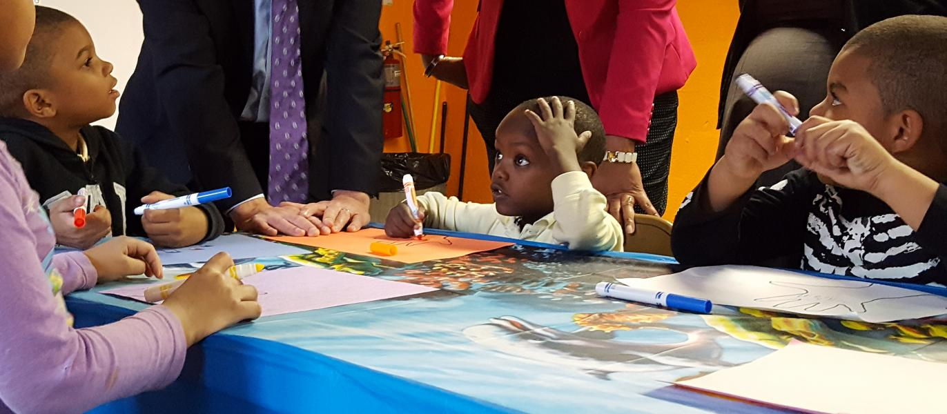 Children work on art projects at SCS Cornerstone Program at Woodside Houses