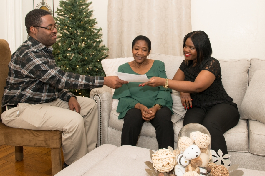 Care NYC staff interacts with family at home