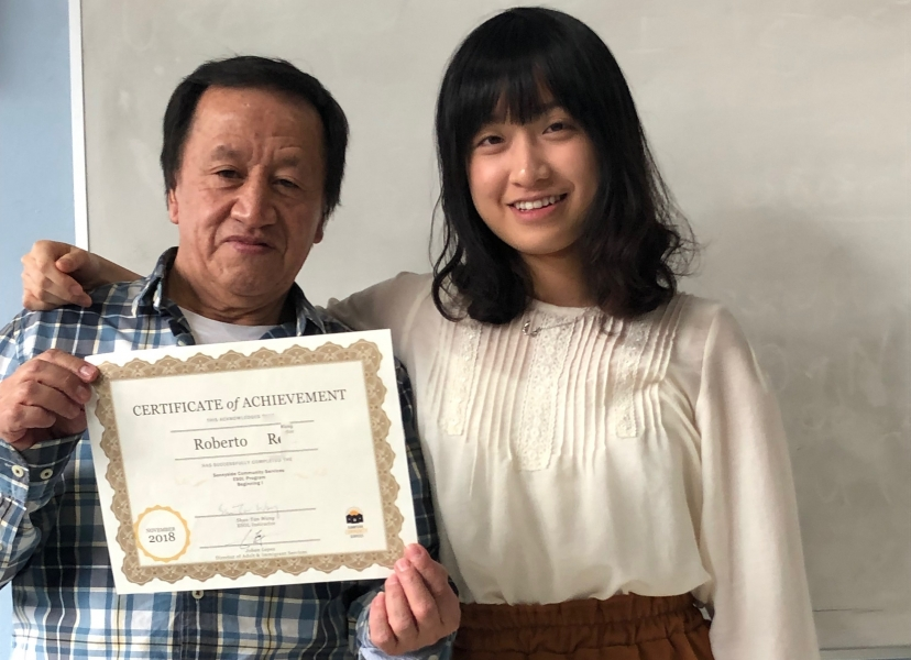 ESOL student graduates from course
