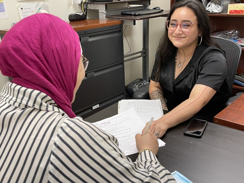 Person receives paperwork from immigration paralegal