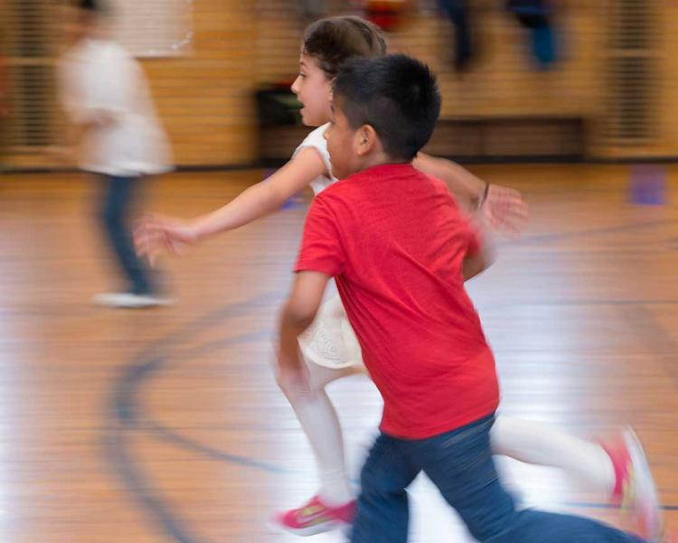 Children run in the gymnasium