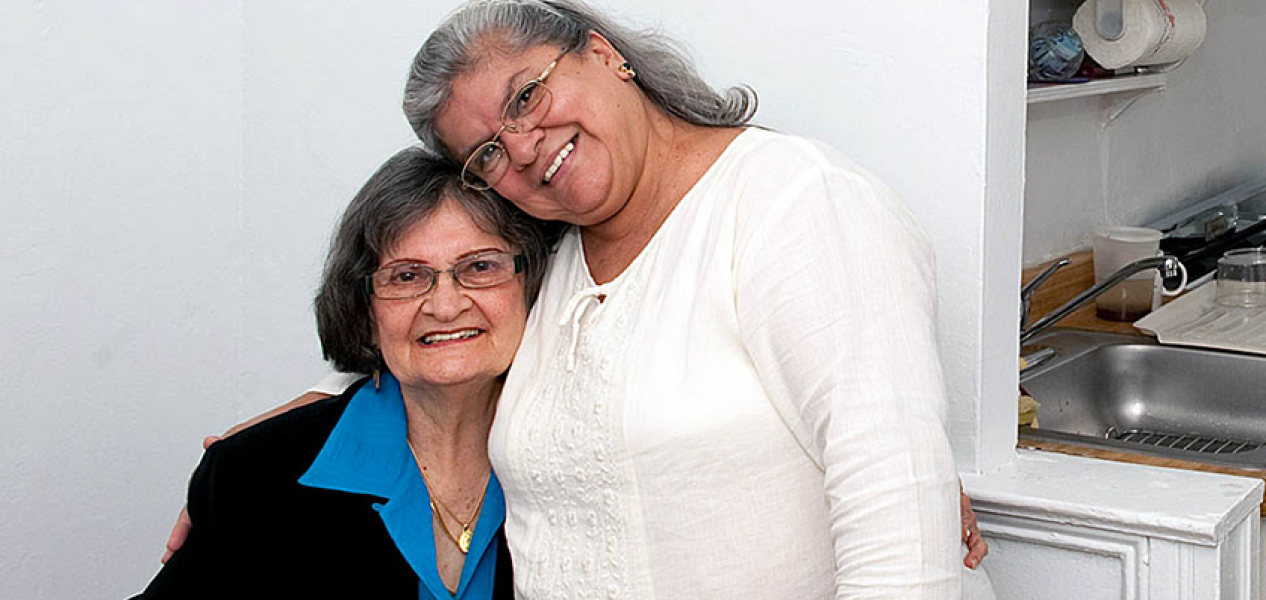 Home care worker and client share a happy moment
