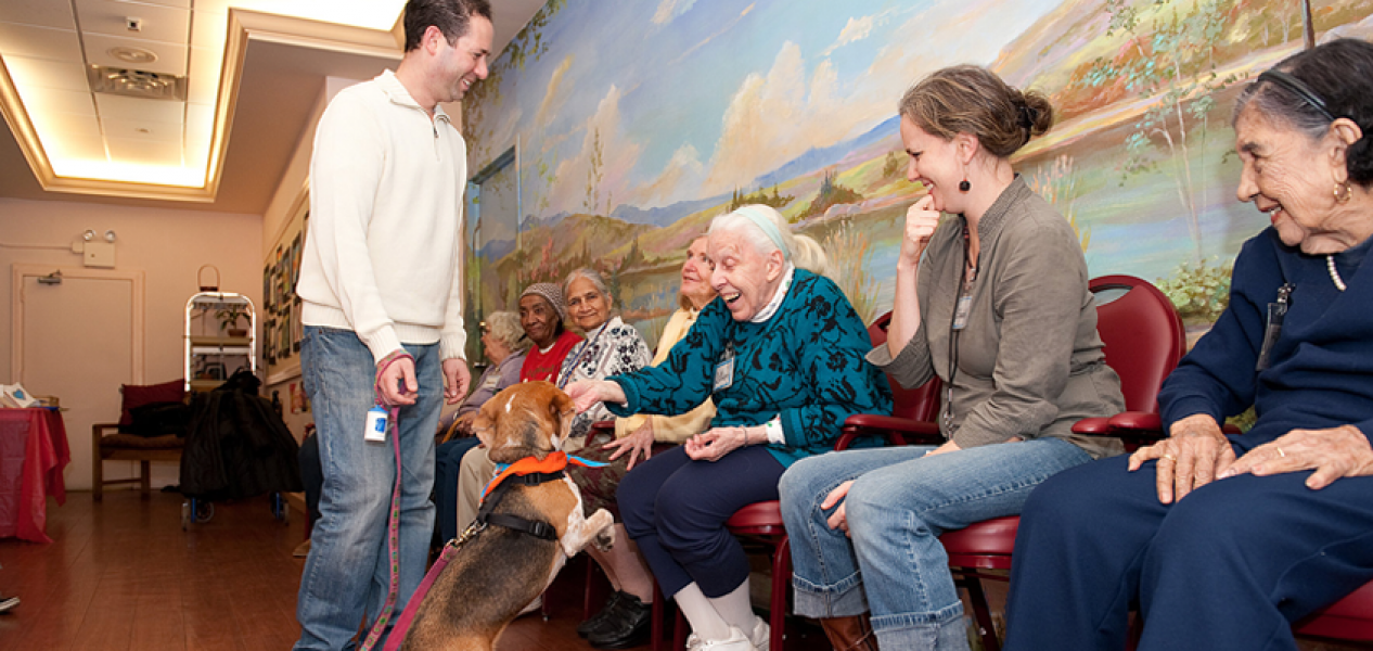 A therapy dog and her owner delight members of the SCS Social Adult Day Program