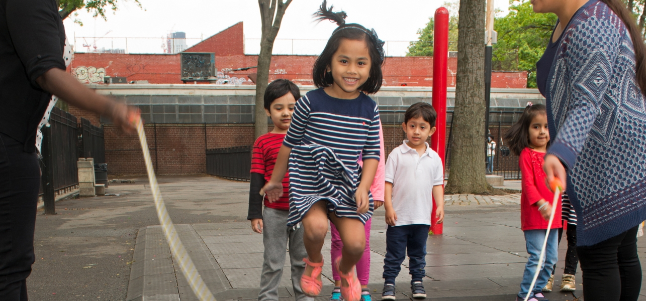 A student in the Sunnyside UP Pre-K program jumps rope outside