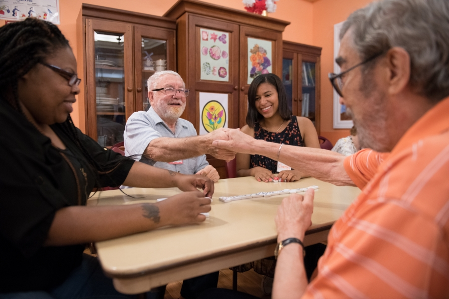 Volunteers interact and play games with participants in SCS Social Adult Day.