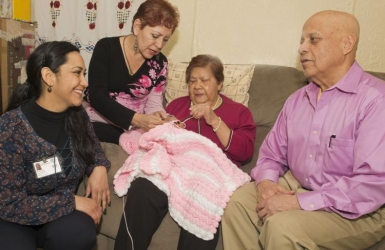 Family and Caregiver with Elderly Woman