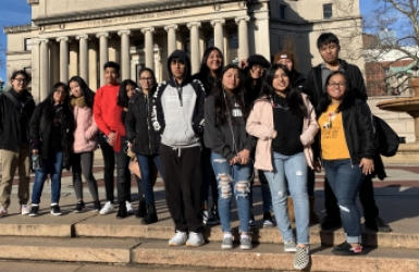 Students from Queens Tech in front of Columbia University Library.