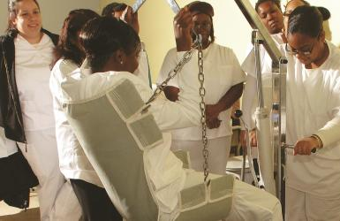 Health Care students watch demonstration of specialized equipment