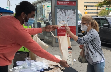 Participants receive masks at COVID outreach
