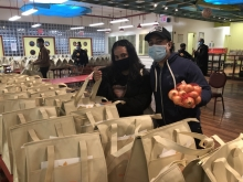Photo of volunteers packing bags for a food drive