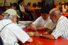 Young and senior participants play board games together